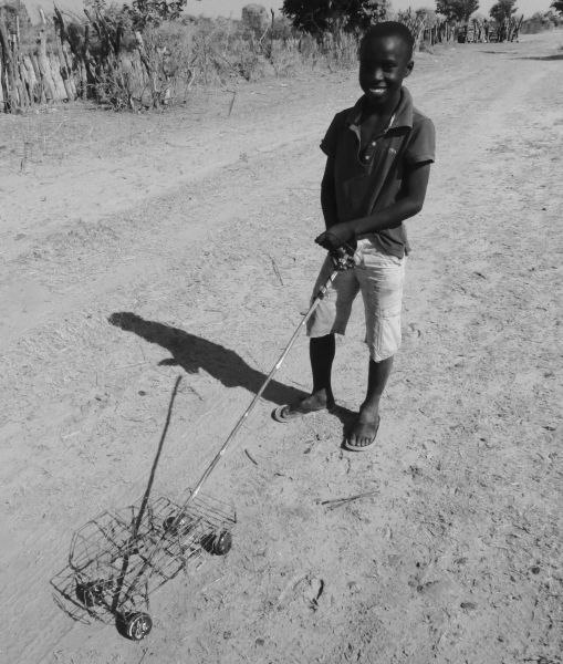 Children playing in the road- the African version of a remote controlled car